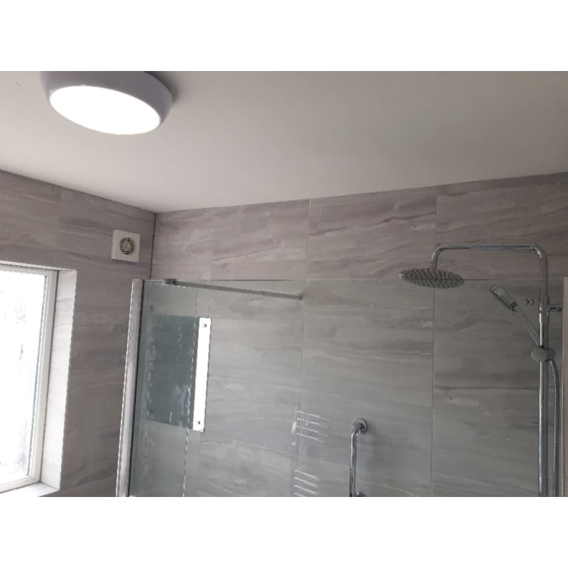 bathroom tiling with shower head fitting